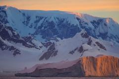 Antarctica_iceberg-mountains_RonNiebrugge